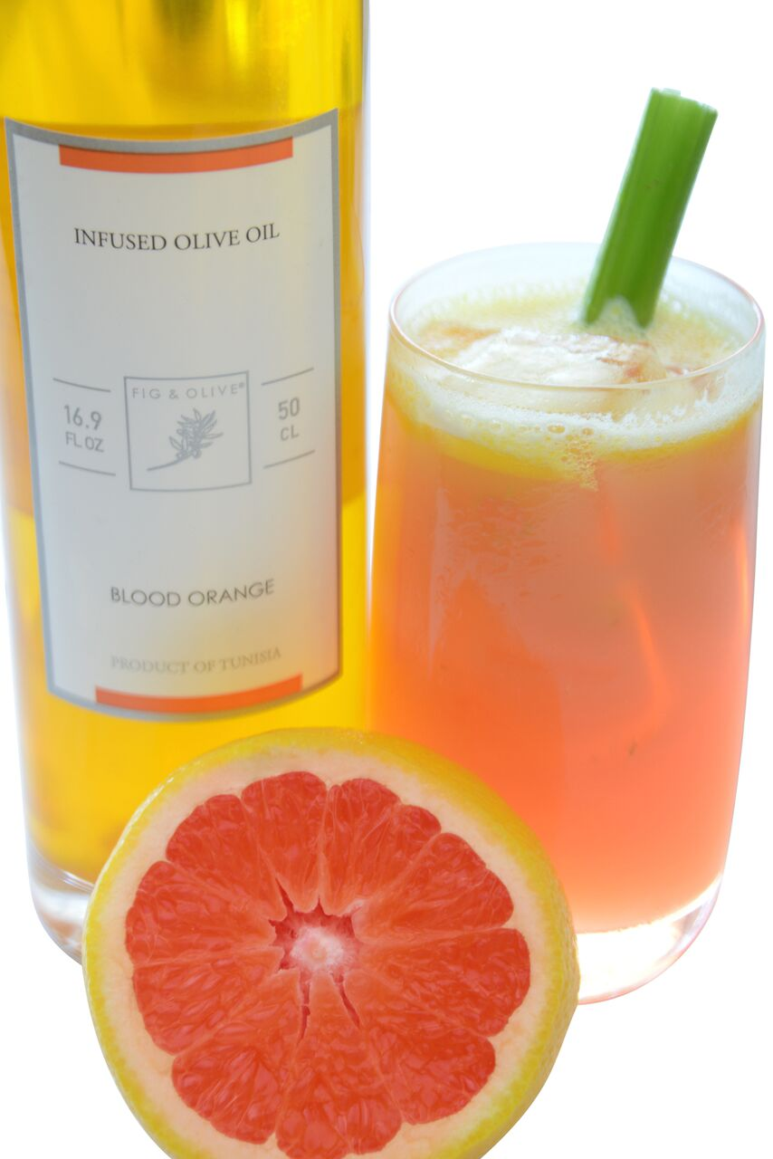 From FIG & OLIVE, The Fig & Olive, organic cucumber vodka, blood orange olive oil, egg white, celery, lime juice, and blood orange puree